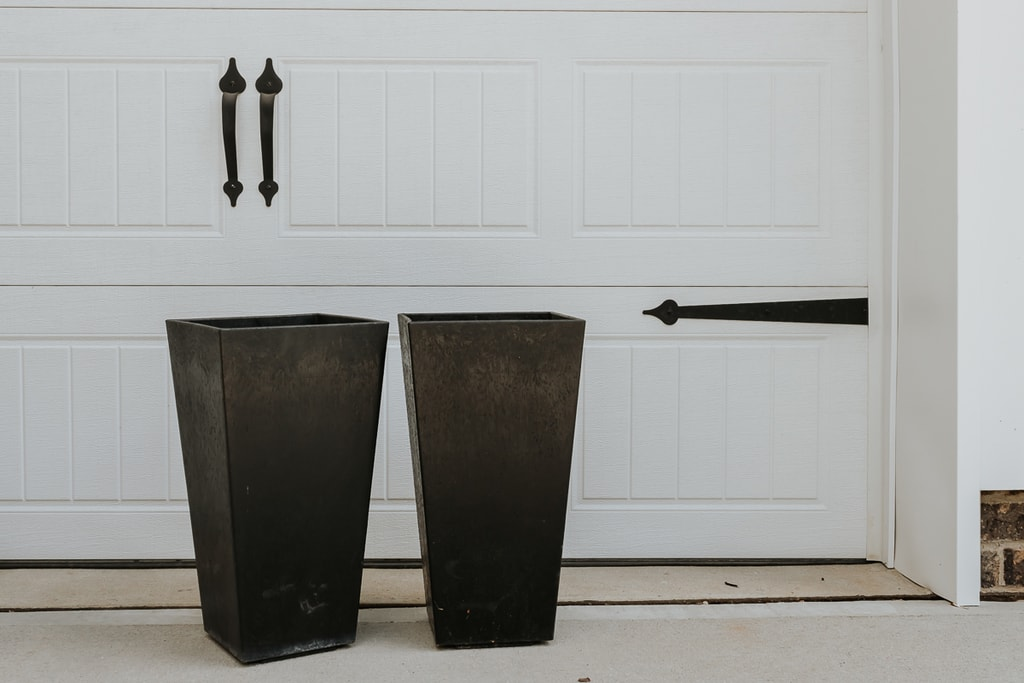 black outdoor planters prepped for spray painting